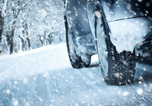 driving-in-blizzard-tire-close-up-in-snow